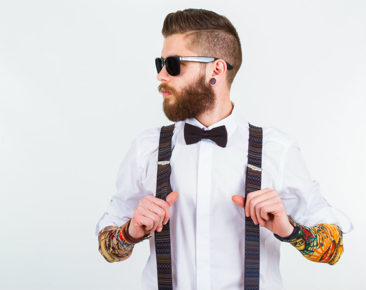 Tattooed man in hipster glasses