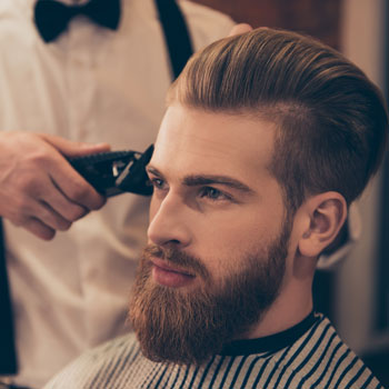 How to speak to your barber best mens haircut guide for all styles a man getting beard trim at barber shop july 2017 solutioingenieria Gallery