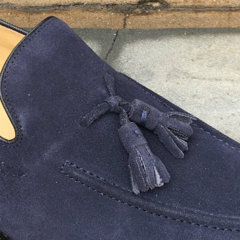 Closeup Of Tassels On Blue Loafer