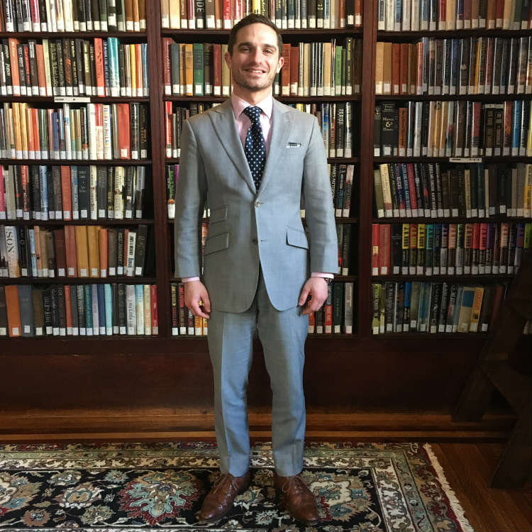 Man In Light Grey Suit In Library