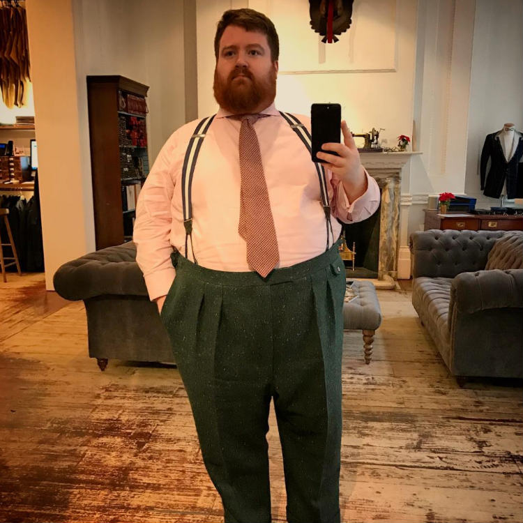 Man In Pink Shirt And Green Pants
