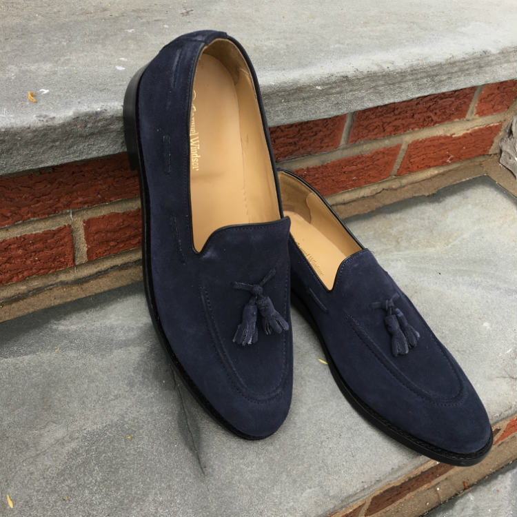 Navy Suede Tassel Loafers On Steps