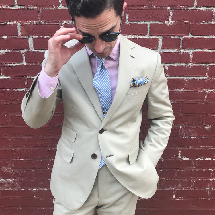 Man In Khaki Suit And Sunglasses