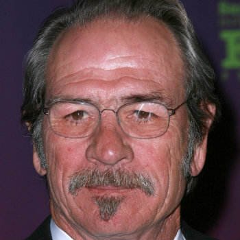 Tommy Lee Jones in oval glasses frames