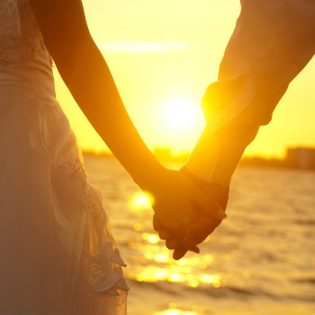 Couple-Holding-Hands-In-Sunset