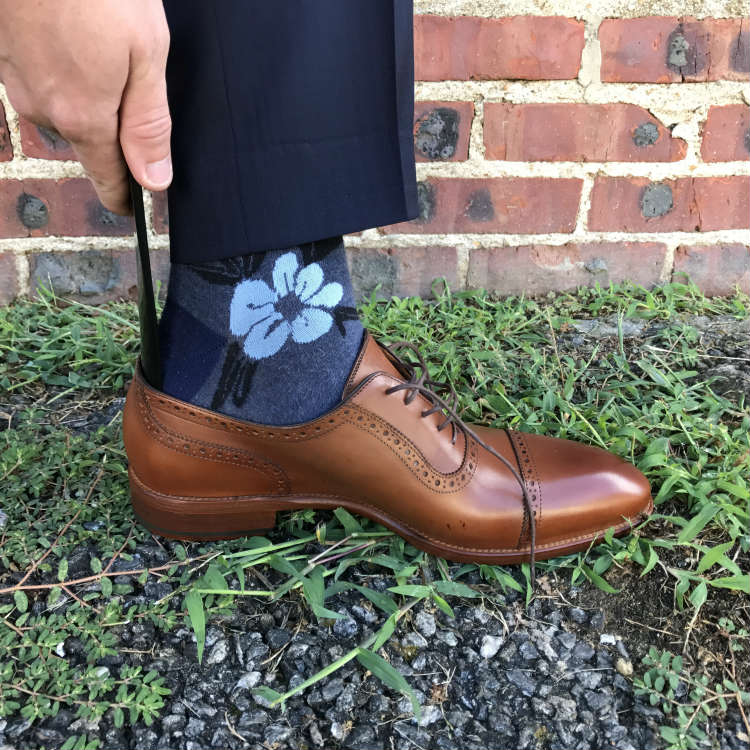 Shoe horn in brown dress shoe
