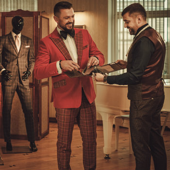 Tailor-And-Client-Looking-At-Fabrics