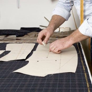cutter tracing out pattern on fabric