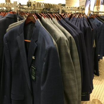 off the rack suits in a store
