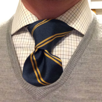 striped tie against check shirt