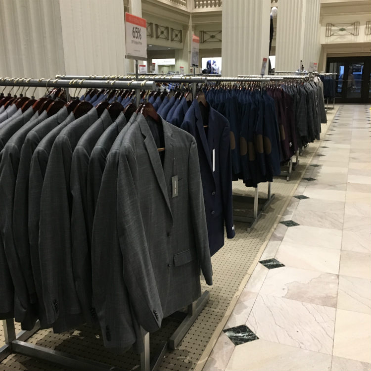 suits on racks in a store
