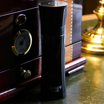 Armani Code Bottle In Front Of Cigar Humidor