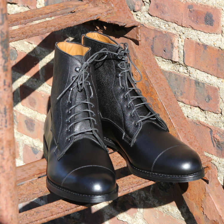 black allen edmonds boots on fire escape