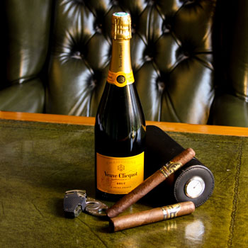 Veuve Clicquot Carte Jaune Champagne & Davidoff Cigars On A Leather Desk