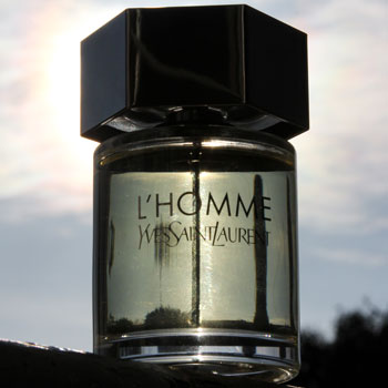 Yves Saint Laurent L'Homme Bottle In Front Of Sun
