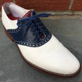red white and blue saddle shoe