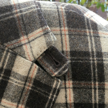 wind tab on plaid blazer