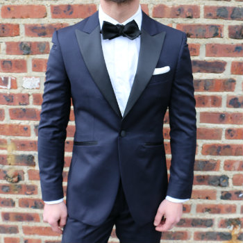 midnight blue tux with black bow tie
