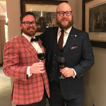 two men in cocktail attire