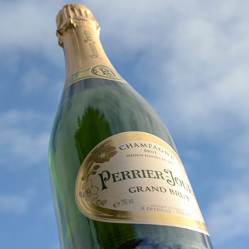 Perrier Jouet Grand Brut Champagne Sky Background