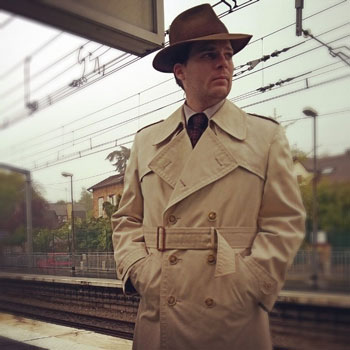 Man In Fedora & Trench Coat