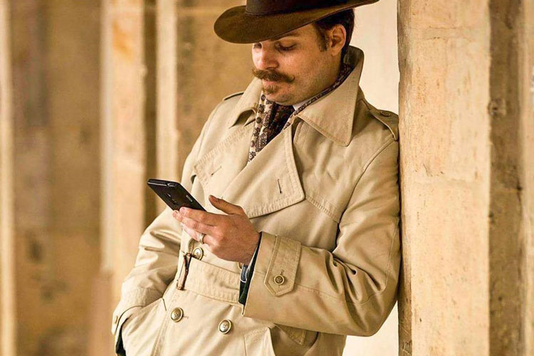 Man With Moustache In Vintage Fedora & Trench Coat