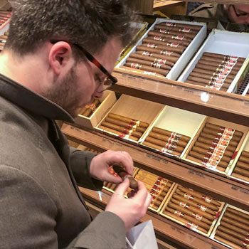 Selecting Cigars At A Tobacconist's