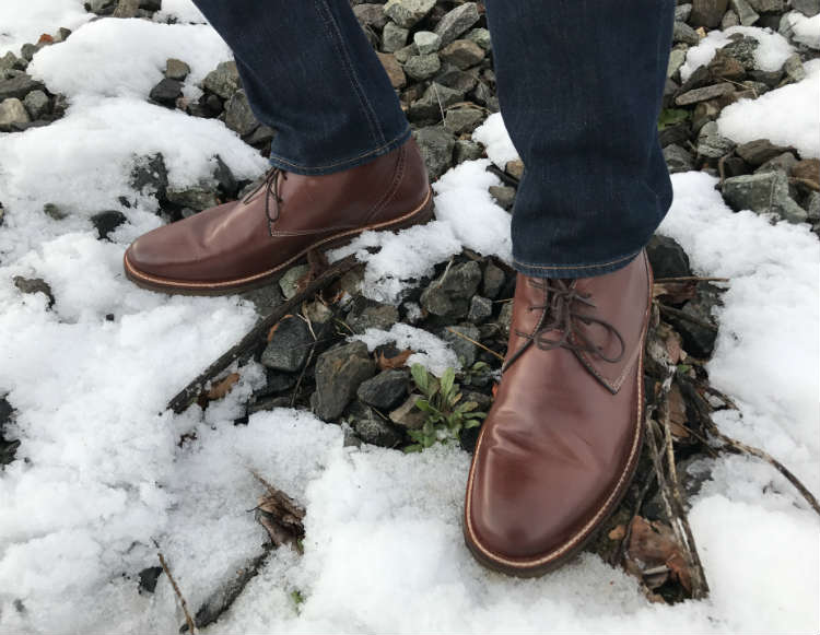 Brown Leather Boots On Snow