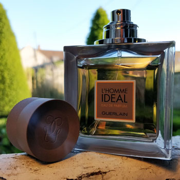 Guerlain L'Homme Ideal Eau de Parfum Bottle On Window