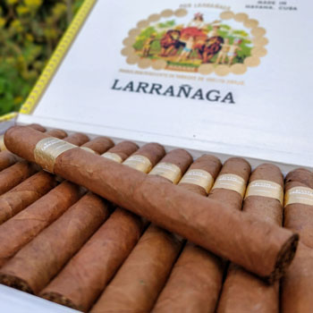 Row Of Por Larrañaga Cigars In Box