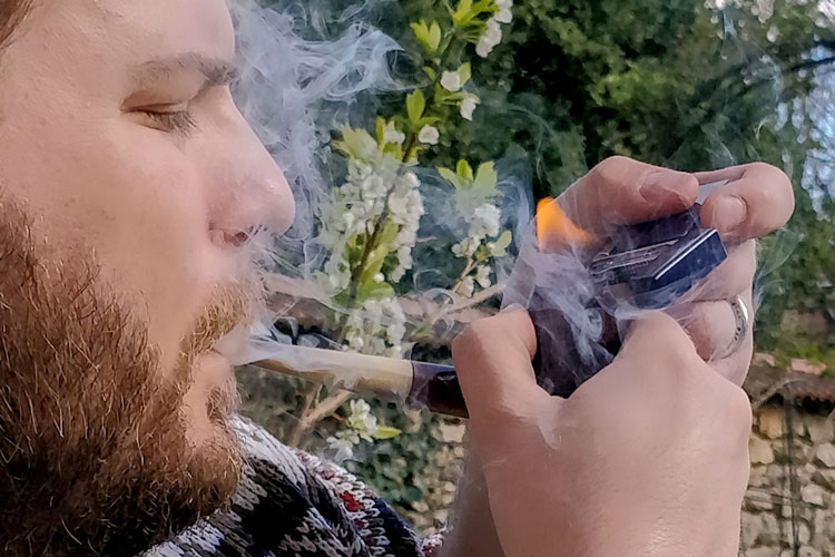 Lighting A Tobacco Pipe