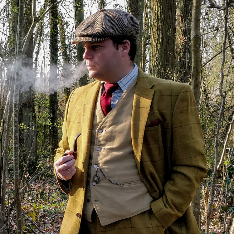 Gentleman In Tweed Suit Smoking An Oom-Paul Pipe
