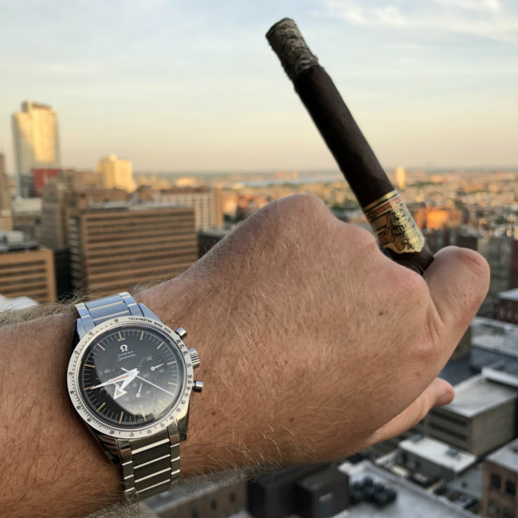 Speedmaster 57 With Cigar Sunset Background