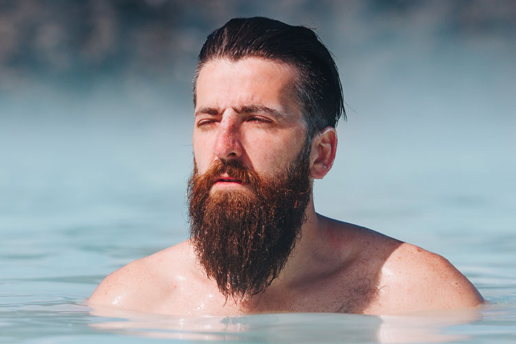 Bearded Man Swimming In Lake